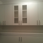 Custom cabinets and countertop in laundry room. SmartSpaces.com