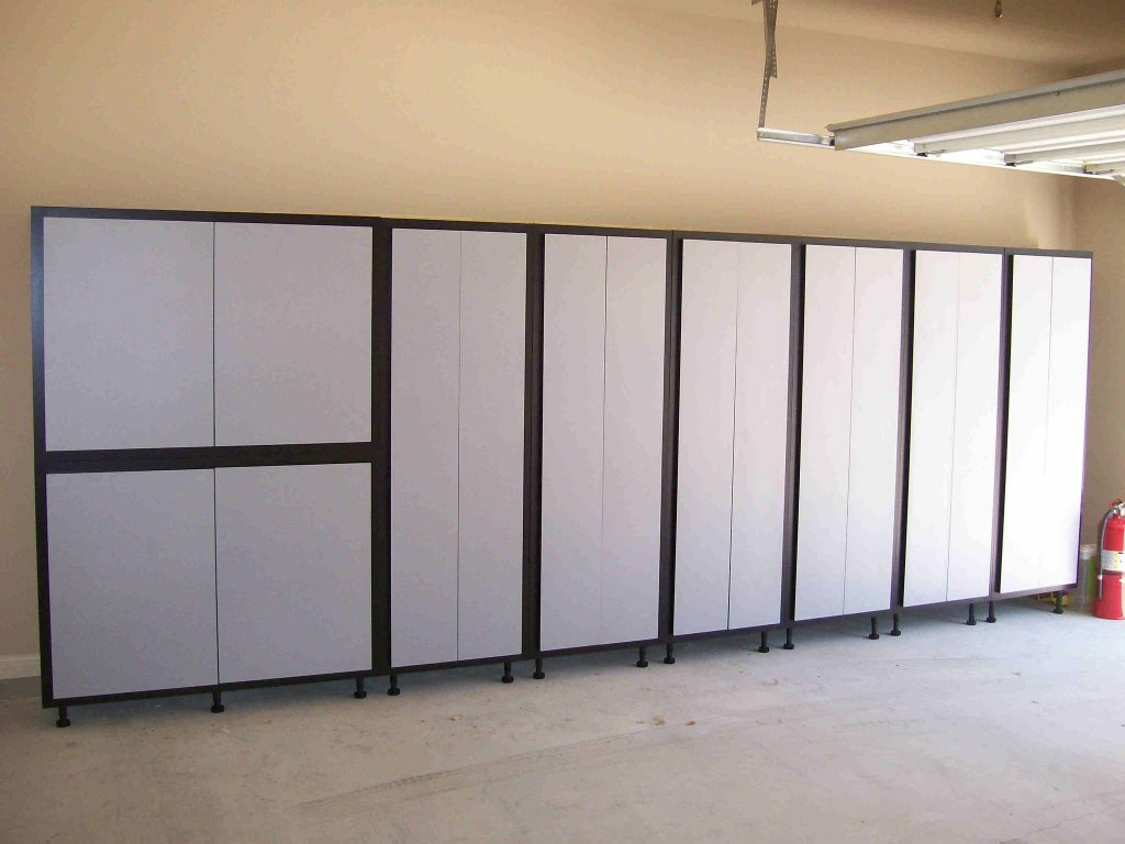 Custom Cabinets in garage, for extra storage. SmartSpaces.com